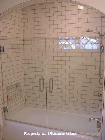 subway tiles  frameless glass enclosed tubgorgeous