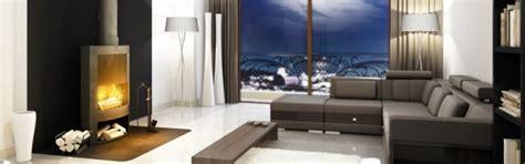 kaminofen aufstellen vorschriften modern eingerichtetes wohnzimmer mit einem modernen kaminofen aus dunkelgrauem stahl