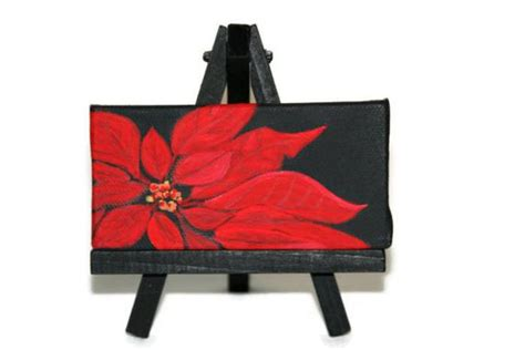 It would make a fun addition to any decor! Painting Poinsettia Acrylic On Black Canvas Miniature