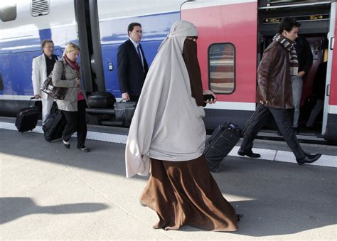 veiled women arrested  french burka ban   force