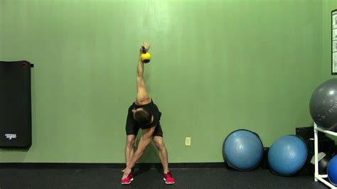 toe touch windmill exercise kettlebell opposite demonstration kettle bell