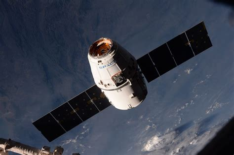 SpaceX supply ship completes journey to space station ...