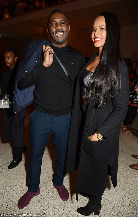 Idris Elba and Sabrina Dhowre attend London exhibition ...