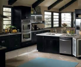 cherry cabinets with a gray kitchen island schrock