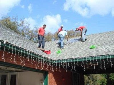 putting christmas lights on roof light installation and removal island ny