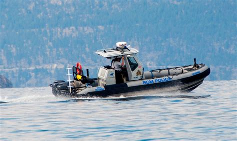 Boat Crash Kelowna by Cabin Cruiser Crashes Into Shore After Thrown Into