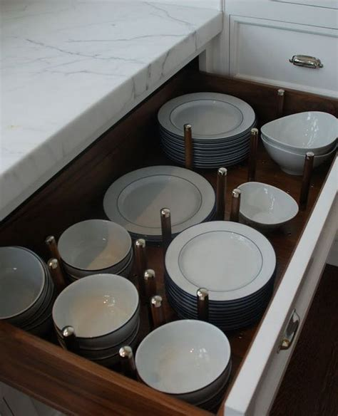 where to put dishes in kitchen cabinets great idea place dishes in pot and pan drawers instead of 2191