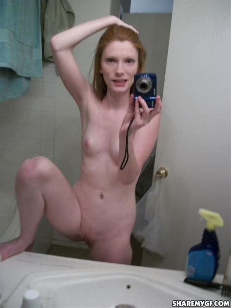hot ginger gf shows off as she takes naked selfies in the bathroom