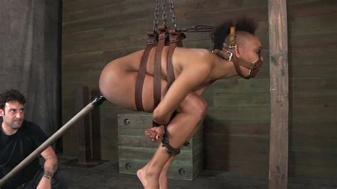Ebony Slave Girl Is Hogtied And Suspebnded Under The Ceiling
