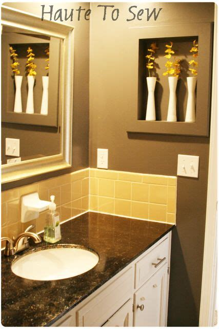 bathroom makeover yellow gray color scheme cabinets