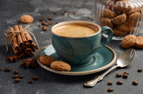 Download and use 10,000+ coffee stock photos for free. Cup of fresh coffee with amaretti cookies on dark background | Premium Photo