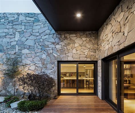 layers serene rustic retreat  stone walls blends