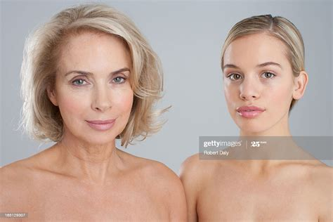 Portrait Of Smiling Bare Chested Mother And Daughter High Res Stock Photo Getty Images