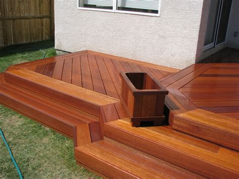 exotic decking stairs  planter box traditional