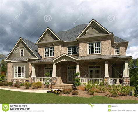 Luxury Model Home Exterior Stormy Weather Stock Photos