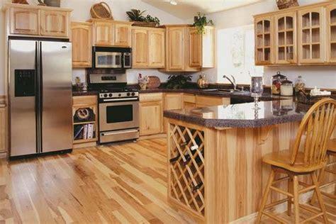 hickory kitchen cabinets  dark granite countertops