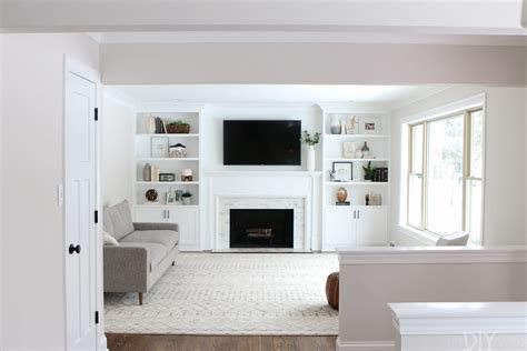 White Builtins Around The Fireplace Before And After
