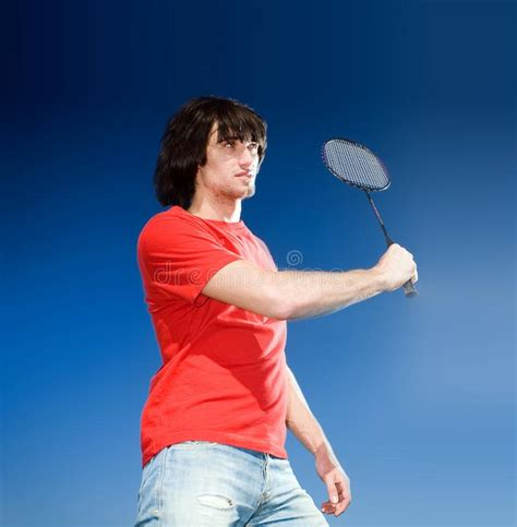 This is a great kids tennis racket for ages 11 and up. Boy With Racket On Blue Background Stock Image - Image of blue, outdoor: 14850517