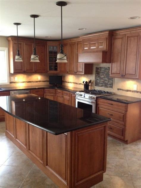 kitchen island countertop black granite countertops in a wooden kitchen with