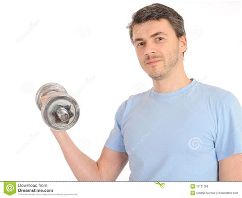 healthy man working out with free weights stock photo
