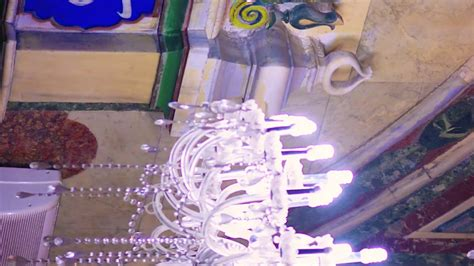 vertical panning shot  arabic calligraphy  chandelier