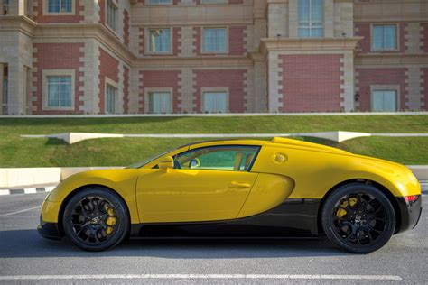 yellow bugatti 2012 bugatti veyron grand sport black yellow review