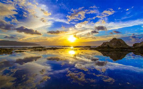 gold sun reflection oahus north shore  hawaii country