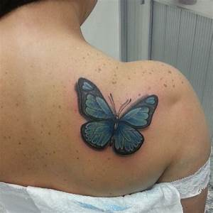 Blue Colored Butterfly Tattoo On Back Shoulder For Women ...