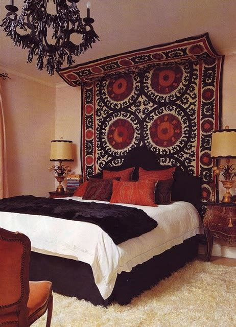 tapestry with lights behind tapestry above bed