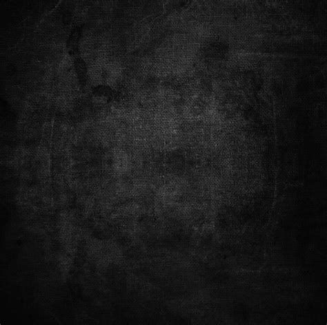 Abstract grunge texture on black fabric