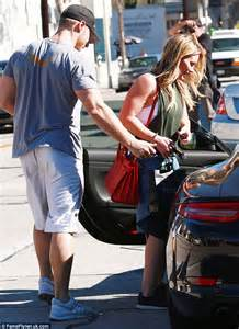 Hilary Duff escorted to car by buff mystery man after gym ...