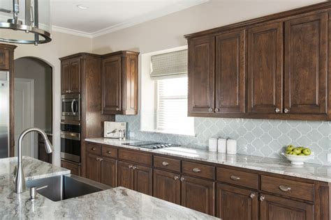Backsplash Ideas For Brown Cabinets by Brown Cabinets Backsplash Ideas