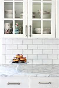installing subway tile backsplash in kitchen 25 best ideas about subway tile backsplash on subway tile kitchen white kitchen