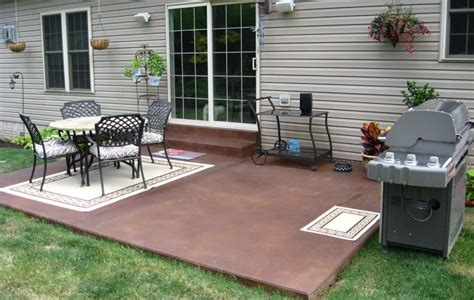 Small Backyard Concrete Patio Designs by Patio Terrace House With A Ceramic Fireplace Is