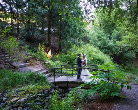newlyweds linger on the bridge winter creek at the uc