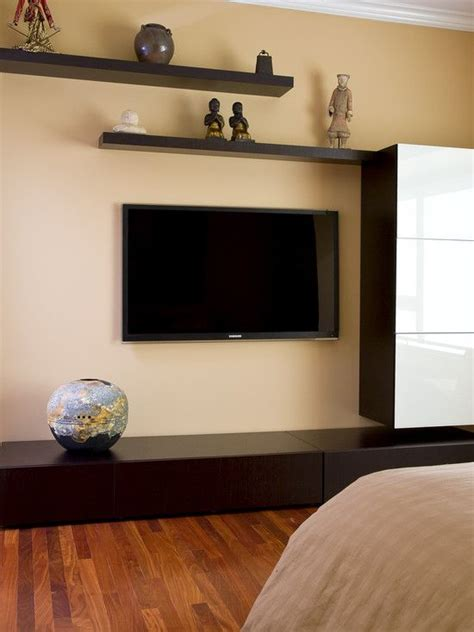 staggered floating shelves  tv decor inspiration