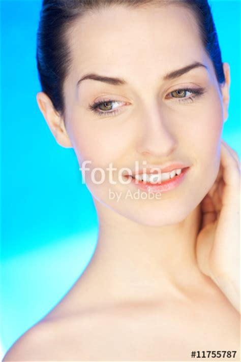 """""""portrait Of 2025 Years Old Beautiful Woman On Blue"""
