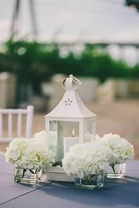 white lanterns candles hydrangea centerpieces