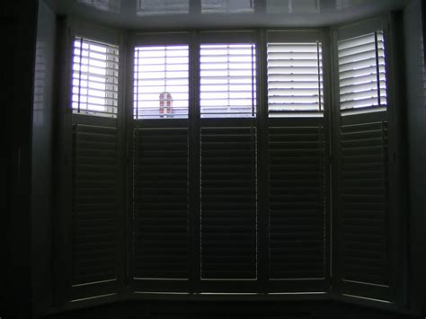 Will Plantation Shutters Make My Room Dark? Curtain Rod Ceiling Mount Brackets Curtains In Spanish Plantation Shutters No Translation Kitchen For French Doors Target Orange Polka Dot Shower Working Out Amount Of Fabric