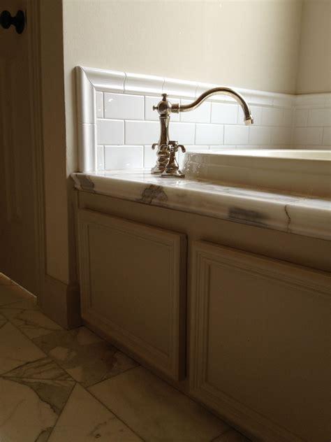 calacutta marble floor  tub deck restoration hardware