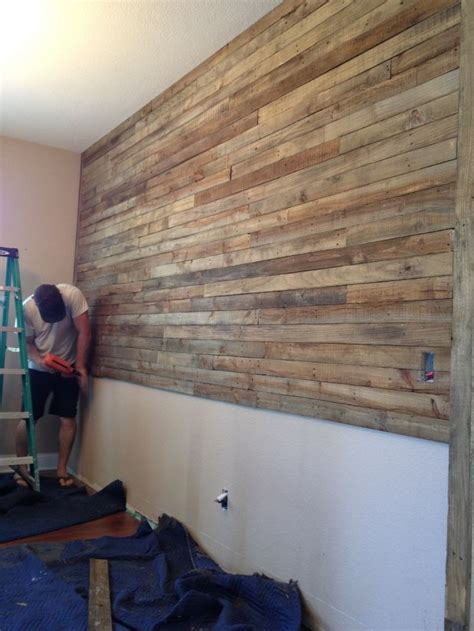 pallet wood accent wall wall made of reused wood pallets and stained with 1 4 mix of minwax walnut stain to 3 4 laquer