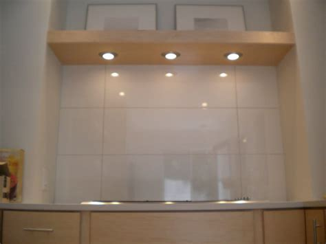 Ross Kitchen. Over sized rectangle tiles, recessed