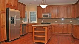 Kitchen with cherry wood cabinets for Cherry wood kitchen cabinets