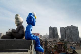 kaws launches  permanent sculpture  china