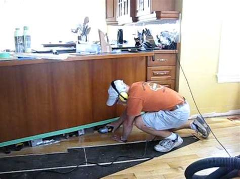 how to install tile flooring in kitchen pageau renovation 2010 day 02 2 claude cutting flooring 9461