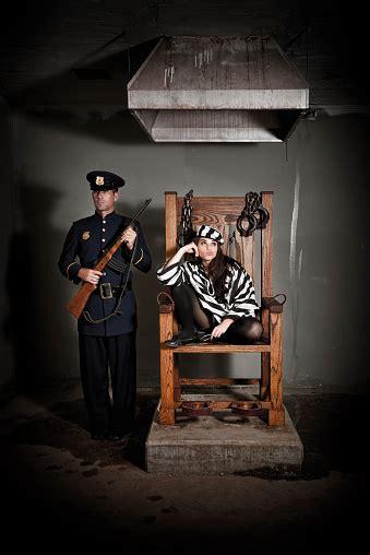 bored female prisoner  electric chair stock photo