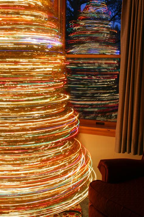 revolving christmas trees with lights long exposure plus rotating christmas tree cool light