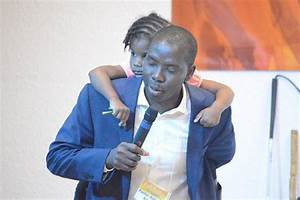 Photos: Nigerian Pastor Carries Baby On His Back While ...