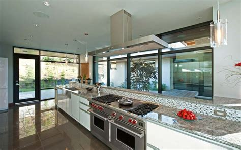lakeside kitchen design stunning lakeside home blends infinity pool with lake and sky 3628