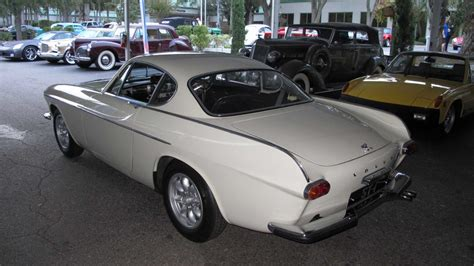 driving roger moores volvo p st